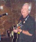 A plays guitar at Gran 7